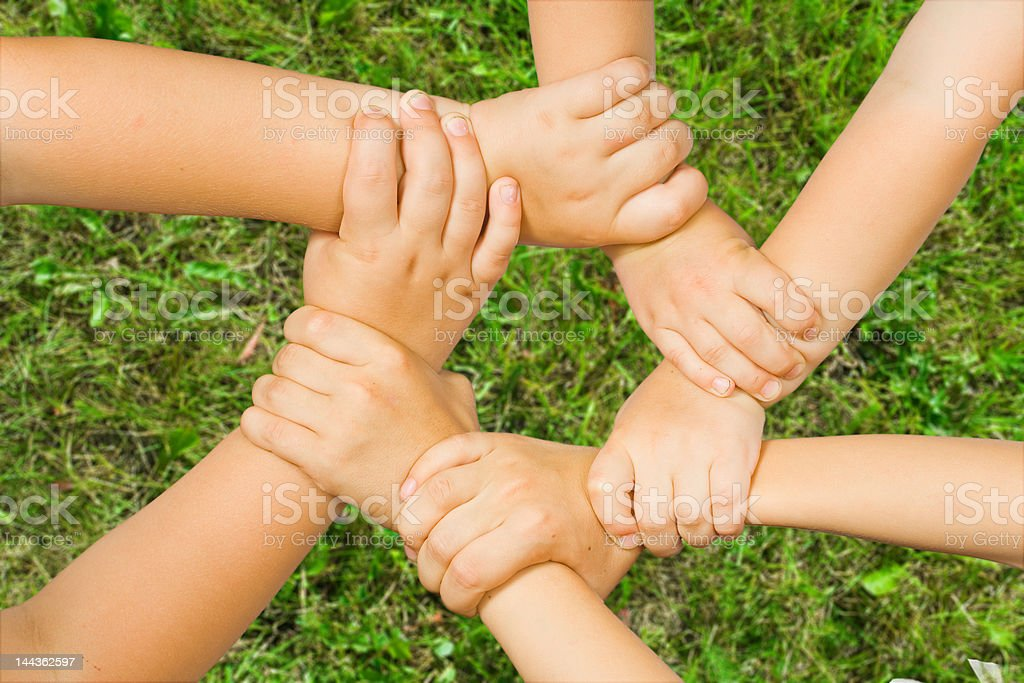 Chain of children's hand stock photo