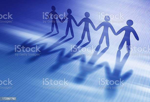 Chain Of People Holding Hands Stock Photo - Download Image Now