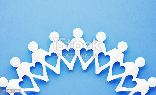 istock Chain Of People Made of Paper on Blue Background: Unity and Strength Concept 1208732003