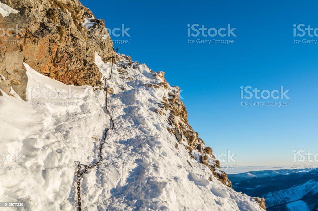 Chain on the trail in winter scenery in the mountains. stock photo