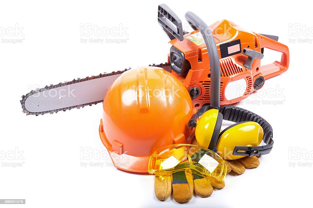 Chain saw and protective clothes. stock photo
