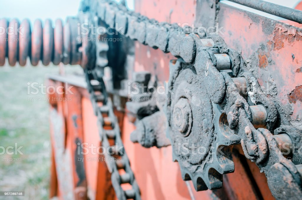 Chain transmission on the old non-operating mechanism. Parts of the old combine harvester. stock photo