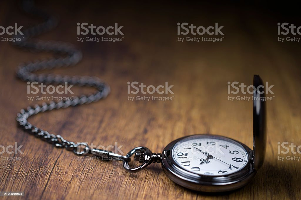 Chain watch and time going by stock photo