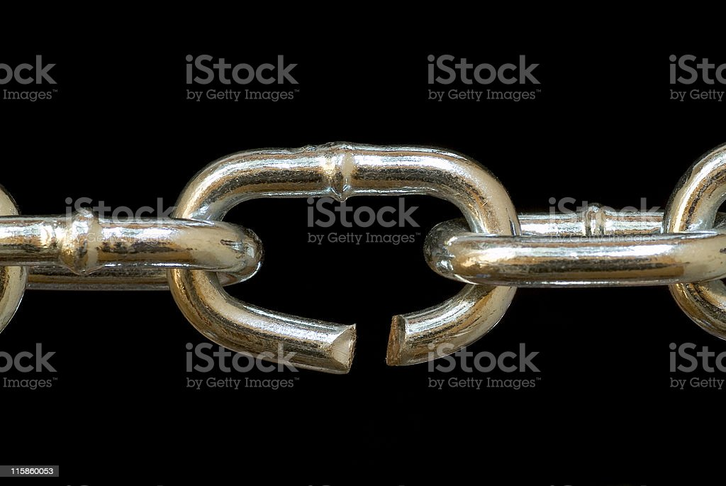 Chain with broken link on black close up stock photo