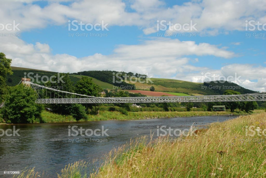 chainbridge over river Tweed at Melrose stock photo