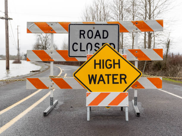 Chained Barricade in Road Closed Sign High Water in Road stock photo