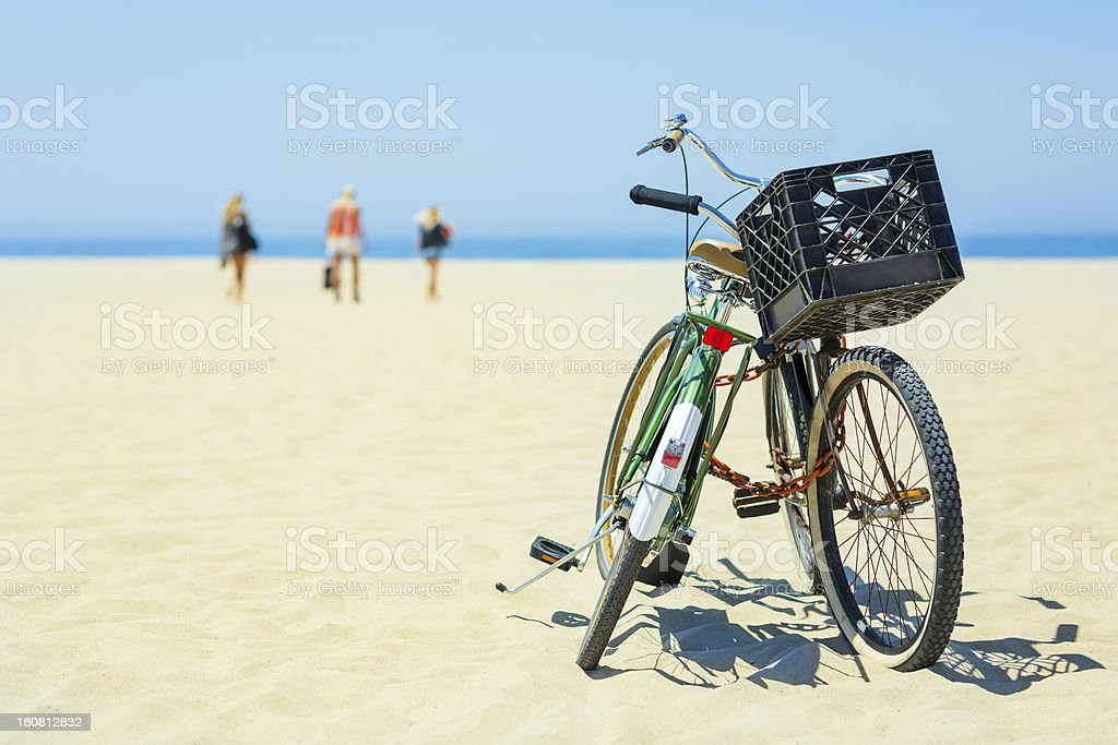 Chained bikes on sandy beach royalty-free stock photo