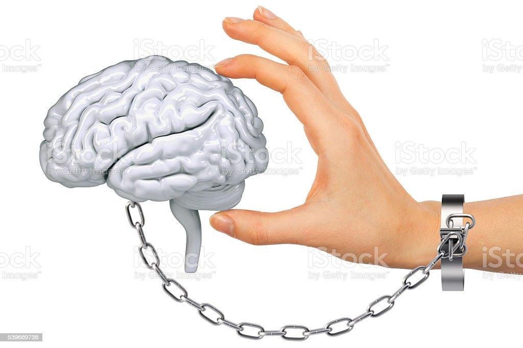Chained hand holding human brain stock photo