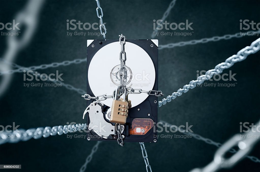 Chained hard disc drive with combination padlock. stock photo