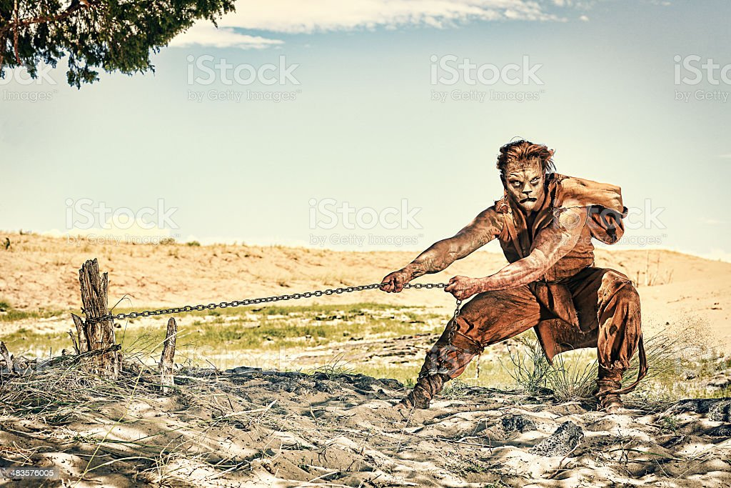 Chained Lion Man stock photo