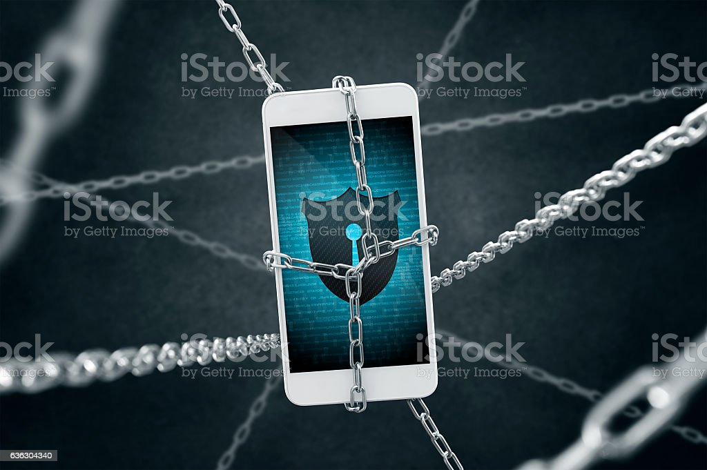 Chained smartphone with antivirus shield. stock photo