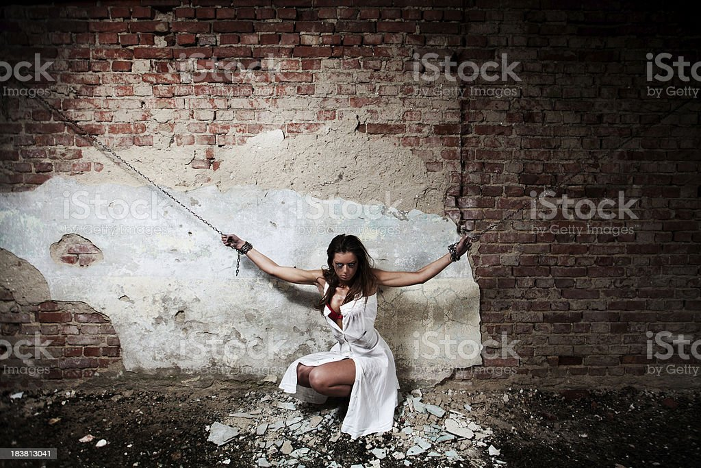 Chained woman in old baisement stock photo