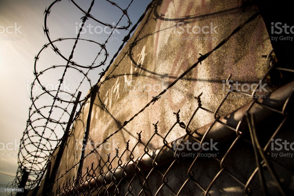 Chainlink fence with barbed wire stock photo
