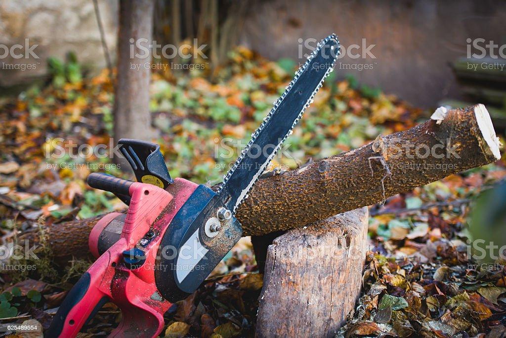 Chainsaw in garden stock photo