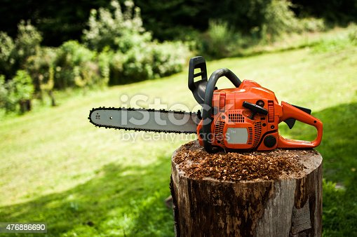 Chainsaw on the wooden stomp