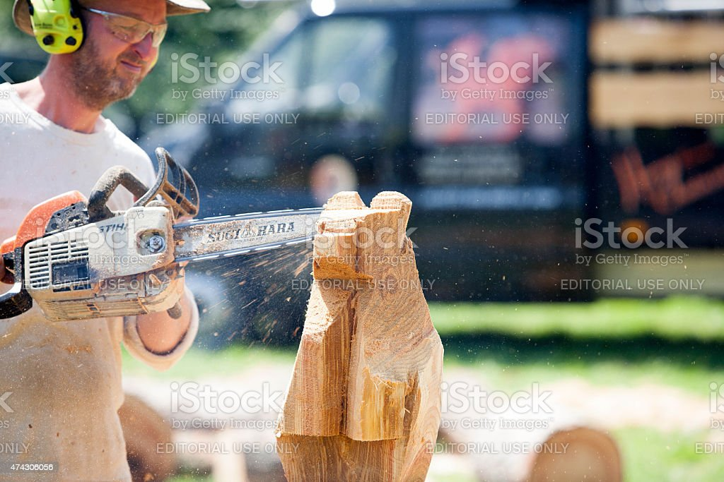 Chainsaw Sculptor Carving A Wooden Bear Stock Photo Download Image