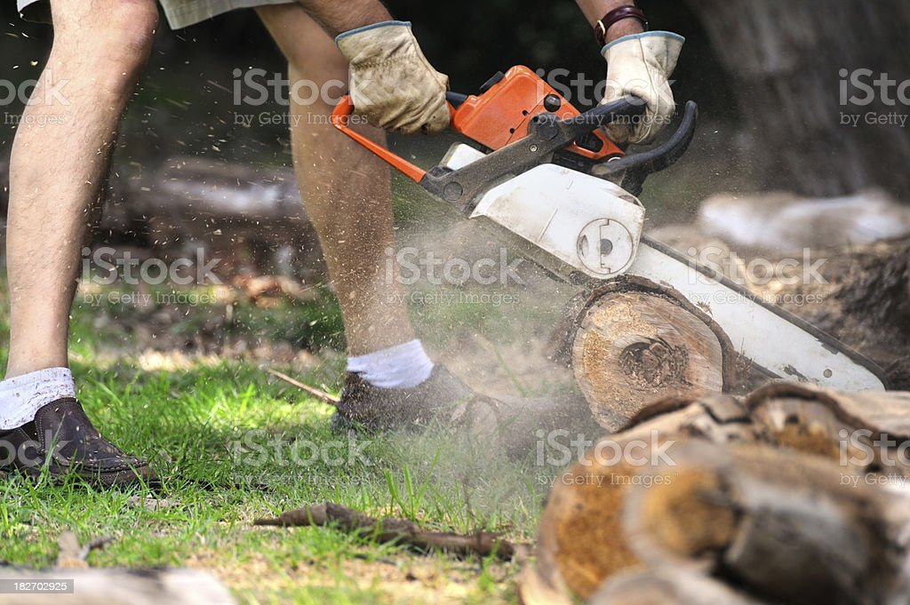 Chainsawing Wood stock photo