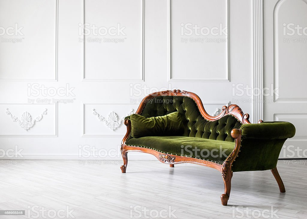 Chair against white wall