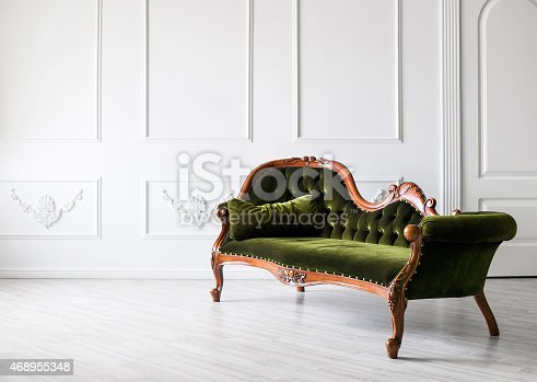 istock Chair against white wall 468955348