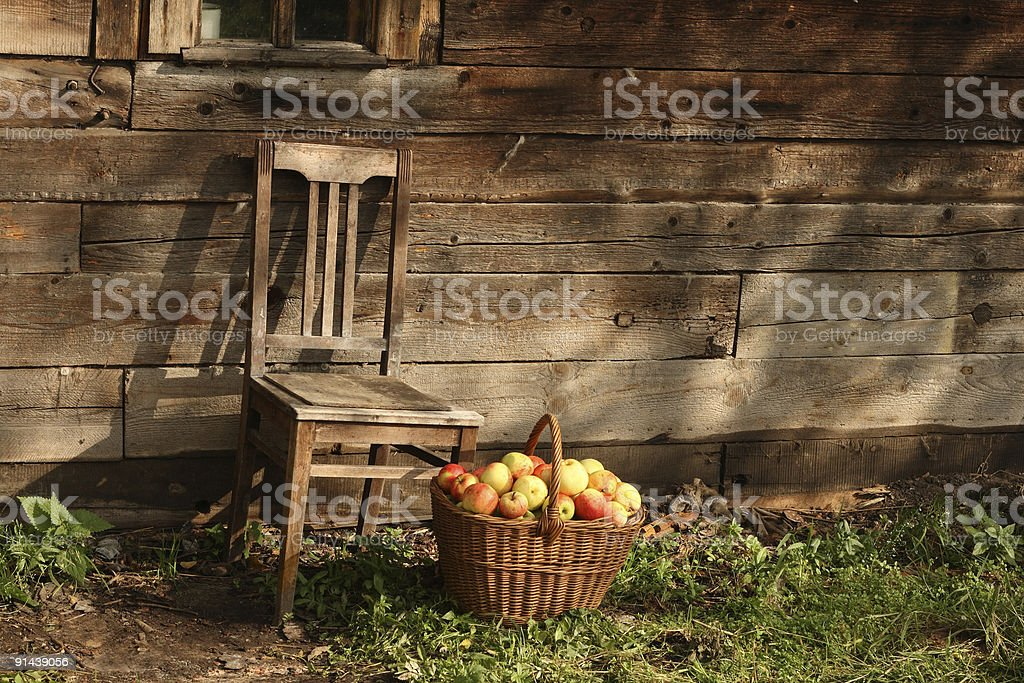 Chair and basketful of apples royalty-free stock photo
