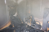 chair , Bed and furniture in room after burned by fire with smoke and dust in burn scene