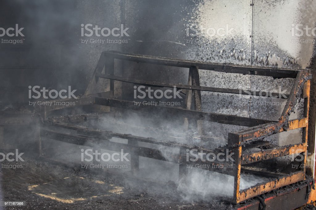 chair and furniture in room after burned in burn scene of arson investigation course stock photo