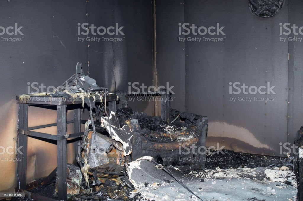 chair and furniture in room after burned in burn scene stock photo