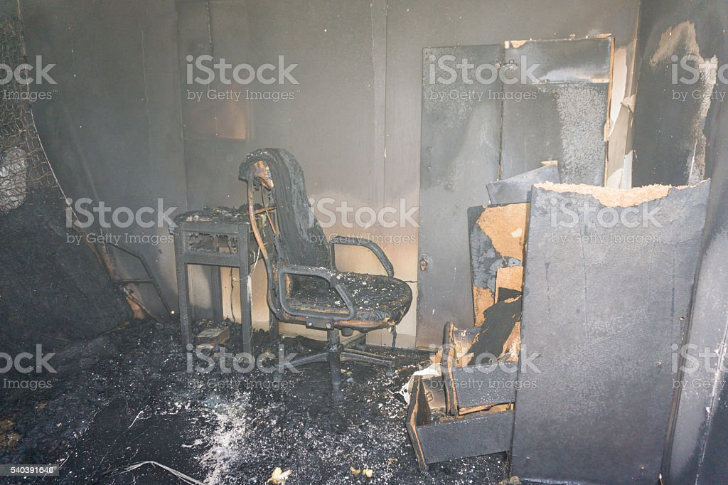 chair and furniture in room after burned stock photo