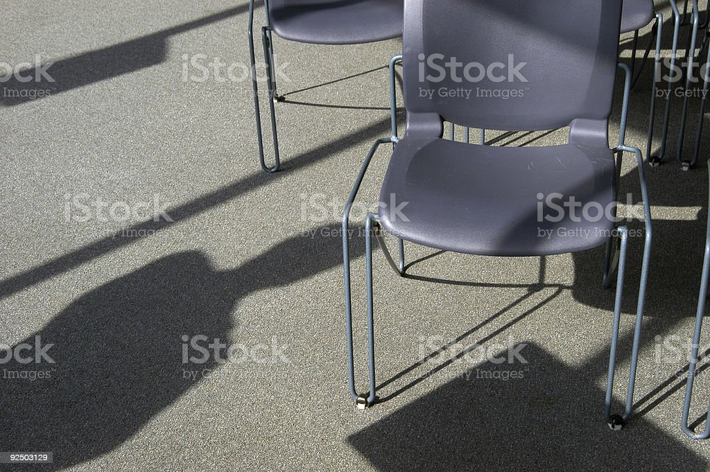 Chair and Shadow Figure royalty-free stock photo
