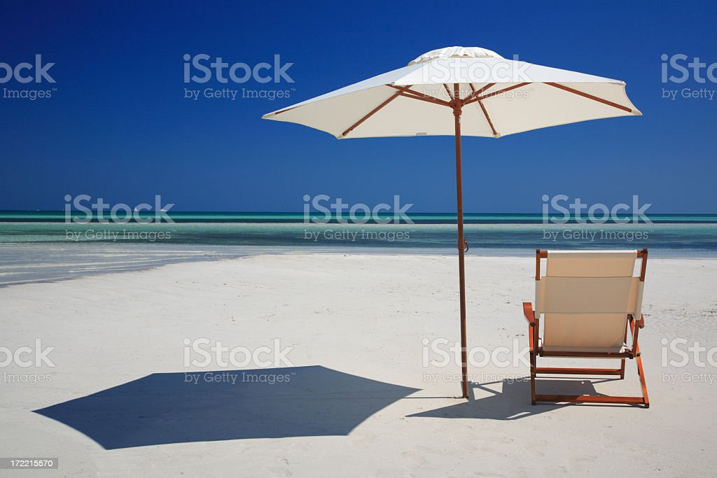 chair and umbrella on the beach royalty-free stock photo