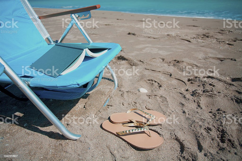 Chair, Book, Flip Flops At The Beach Stock Photo