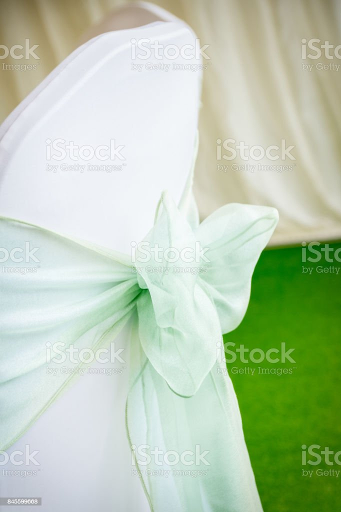 Chair cover with bow (green) stock photo