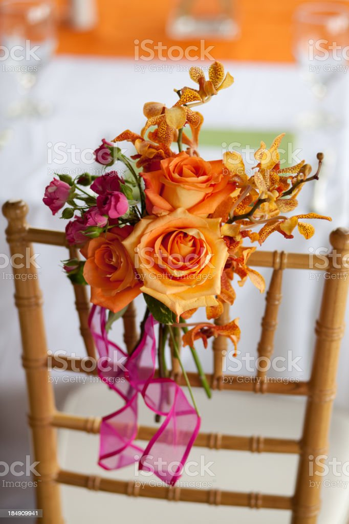 Chair decorated with colorful flowers royalty-free stock photo