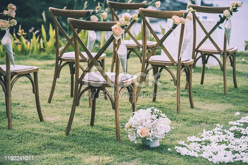 Chair decorated with flowers in Wedding ceremony,Vintage tone.