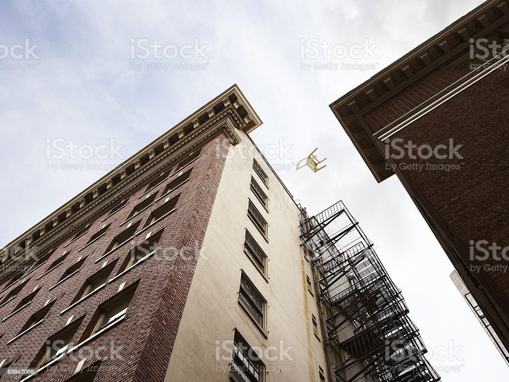 chair falling from a building royalty-free stock photo