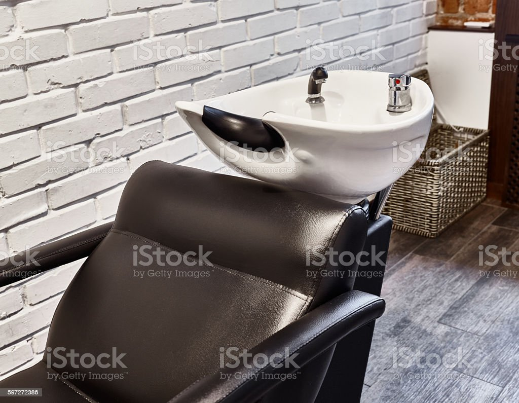 Chair for washing hair at the hairdresser royalty-free stock photo