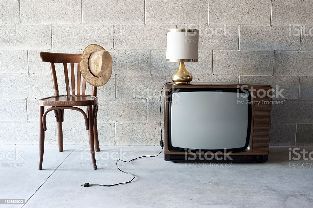 Chair, Hat, Lamp And Old Television royalty-free stock photo