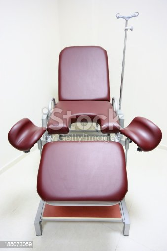 Chair in a gynecologists room.