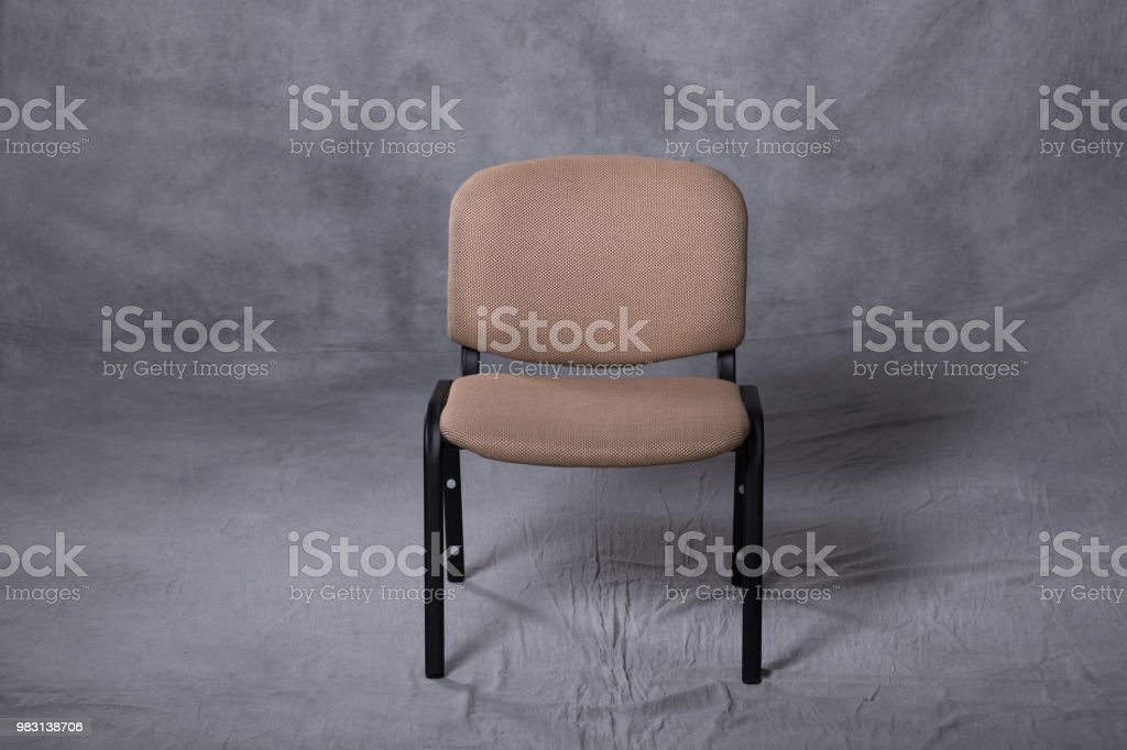 a chair in front of a tie dye pattern abstract background stock