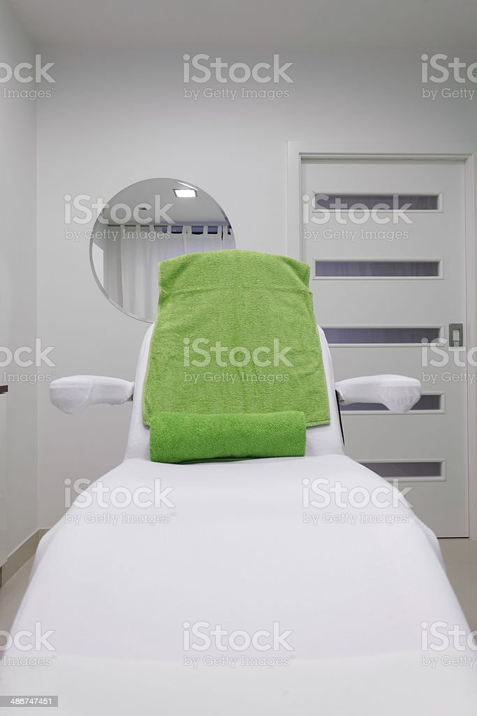 Chair in healthy beauty spa salon. Interior of treatment room. royalty-free stock photo