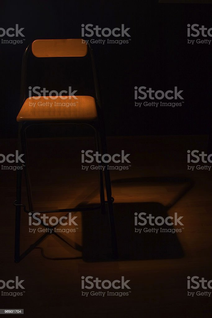Chair in spotlight royalty-free stock photo