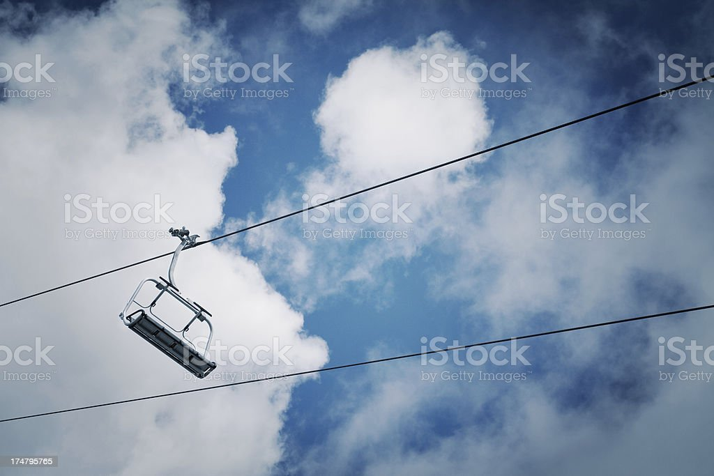 Chair lift and blue sky royalty-free stock photo