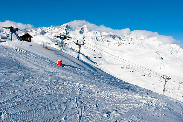 Chair lift and snowy mountains stock photo