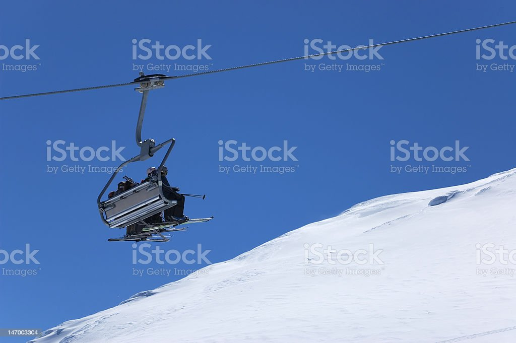 Chair lift at ski resort. Winter vacations royalty-free stock photo