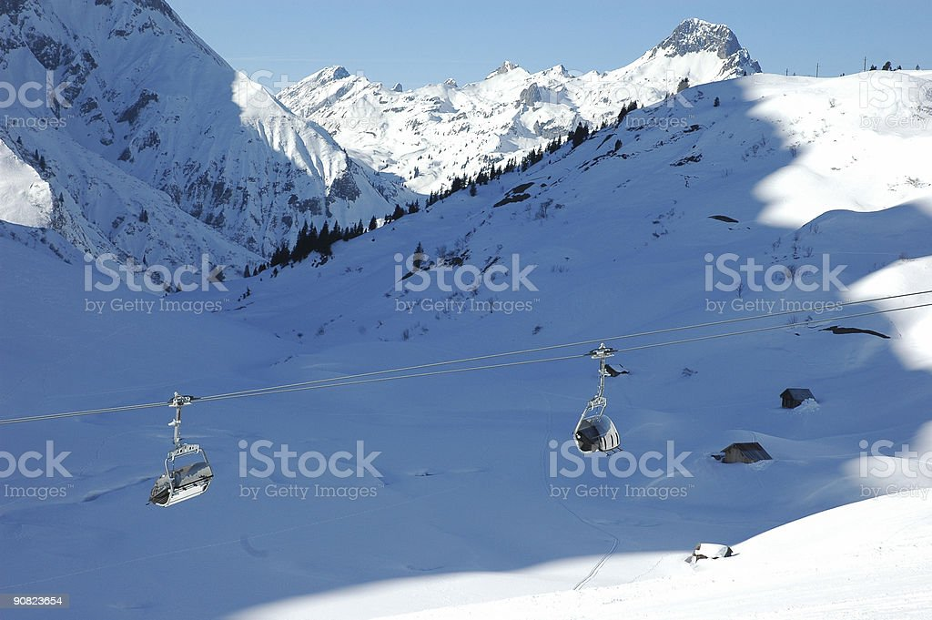 Chair lift in shadow of the paek stock photo