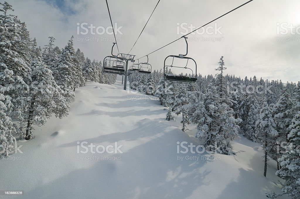 Chair lift in Snowy Winter Landscape royalty-free stock photo