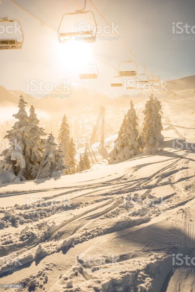 Chair lift in the sun royalty-free stock photo