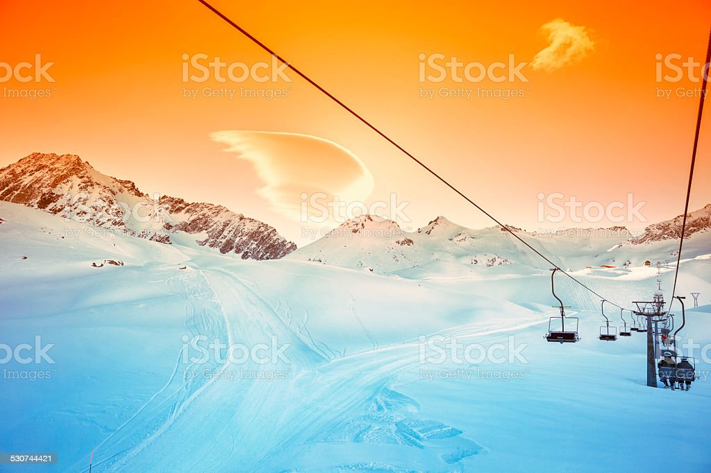 Chair Lift     Ski resort    Skiers on the skilift going up stock photo
