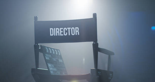 Chair of director with clapboard in spotlight Empty black chair with sign Director and clapperboard in spotlight on filming set director stock pictures, royalty-free photos & images