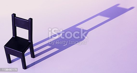 istock Chair on a colored background, hard light, shadow. The concept of design ideas. 1138492175